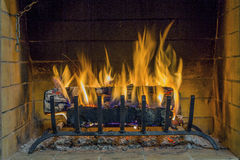 Fire in fireplace. Closeup of firewood burning in fire. Royalty Free Stock Photography