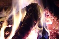 Fire in a fireplace in detail. Fireplace with fire from a rustic house stock images