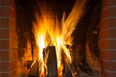 Fire in fireplace. Fire background. Blazing Bonfire. Firewood burns in a fireplace Royalty Free Stock Image