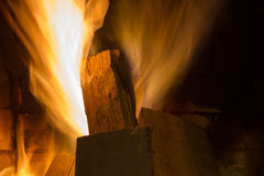 Fire in fireplace. Fire background. Blazing Bonfire. Firewood burns in a fireplace Royalty Free Stock Photo