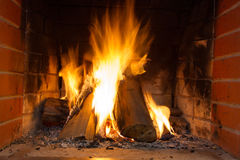 Fire in fireplace. Fire background. Blazing Bonfire. Firewood burns in a fireplace. Stock Photo