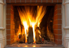 Fire in fireplace. Fire background. Blazing Bonfire. Firewood burns in a fireplace. Stock Image
