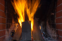 Fire in fireplace. Fire background. Blazing Bonfire. Firewood burns in a fireplace. Stock Images