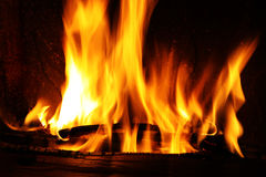 Fire in a fireplace, fire flames on a black background. Pattern royalty free stock photo