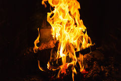 Fire in fireplace. Fire and flame in fireplace Stock Image