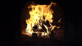 Fire in a fireplace. Fire in the furnace stock footage