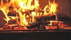 Fire in fireplace - Hot embers burning with orange flame stock video footage