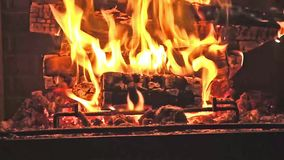 Fire in fireplace - Hot embers burning with orange flame stock video