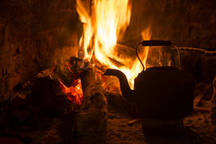 Fire fireplace kettle wood winter holiday Royalty Free Stock Photography