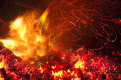 Fire in fireplace Stock Images