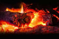 A fire in the fireplace, the smoldering coals of fire. Heat, close-up Stock Photo