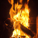 Fire in the fireplace. A warm fire in a fire place ,in a night of december Stock Image