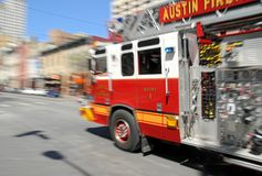 Fire - Firetruck on Rush in Austin, TX. Firetruck with crew on its way to a fire in Austin, Texas Stock Photos