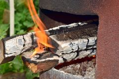 Fire with firewood at a short distance stock photo
