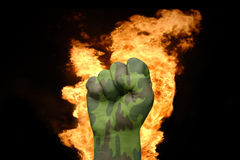 Fire fist with the camouflage texture Stock Photo