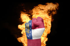 Fire fist with the flag of georgia Royalty Free Stock Images