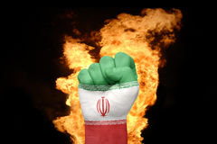 Fire fist with the national flag of iran Stock Photography
