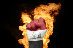 Fire fist with the national flag of iraq Stock Photo