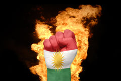 Fire fist with the national flag of kurdistan Stock Photography