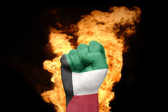 Fire fist with the national flag of kuwait Royalty Free Stock Photo