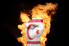 Fire fist with the national flag of northern cyprus Stock Photos