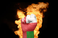 Fire fist with the national flag of oman Stock Photos