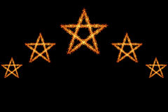 Fire five stars  on black Royalty Free Stock Photos