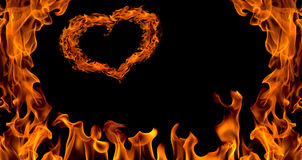 Fire flame background with heart, isolated Stock Photography
