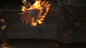 Fire flame burns a wooden surface. stock footage