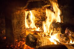 Fire and flame. Fireplace. Black and orange color. Stock Photos