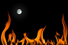 Fire flame and full moon isolated Stock Image