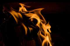 Fire flame. Glowing Fire Flame on black Royalty Free Stock Image