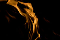 Fire flame. Glowing Fire Flame on black Stock Images
