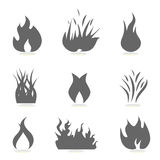 Fire and flame icons. Silhouettes Stock Photos