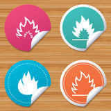 Fire flame icons. Heat signs. Round stickers or website banners. Fire flame icons. Heat symbols. Inflammable signs. Circle badges with bended corner. Vector Royalty Free Stock Photos