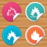 Fire flame icons. Heat signs. Round stickers or website banners. Fire flame icons. Heat symbols. Inflammable signs. Circle badges with bended corner. Vector Stock Photography