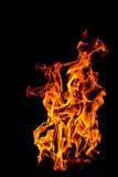 Fire flame isolated on black isolated background - Beautiful yel Royalty Free Stock Photo