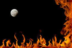 Fire flame and lunar eclipse Royalty Free Stock Image
