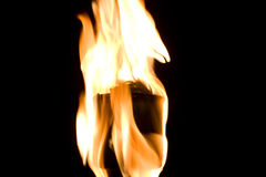 Fire flame torch over black background Royalty Free Stock Images