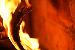 Fire flame V. A flaming and warm wood fire royalty free stock images