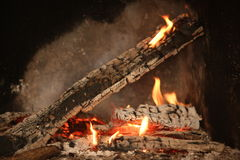 Fire flames. Raising in a fireside Royalty Free Stock Photography