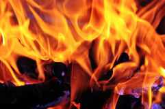 Fire flames. Closeup of red fire flames of a fireplace Royalty Free Stock Photography