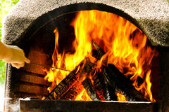 Fire and flames. Wood burning on a fire with red hot flames Royalty Free Stock Photo