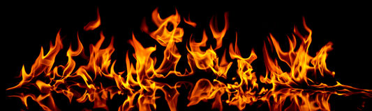 Fire and flames. Fire flames on a black background royalty free stock photo