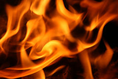 Fire and flames. On a black background Royalty Free Stock Images