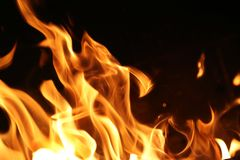 Fire flames. Over black background texture Stock Images