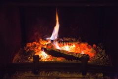 Fire flames with ash in fireplace Royalty Free Stock Image