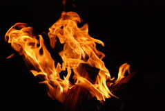 Fire flames on black background Stock Photos