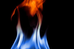 Fire flames on black background. Fire with blue, white and red colors Royalty Free Stock Photos