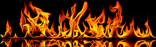 Fire and flames. Fire flames on a black background royalty free stock images